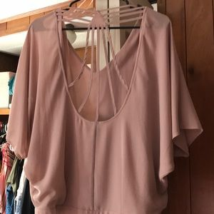 Blush blouse with cross straps on the back